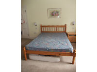 Pine double bed with mattress, little used