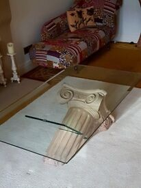 Glass rectangular coffee table with Roman Stone Pillar - Collection only.