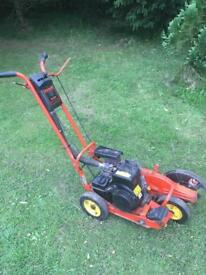 Used Kawasaki HE130A lawn edger for sale