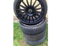 """Black 17"""" Alloy Wheels, Plus Tyres, 2 almost brand new tryes . badged as Vauxhall."""