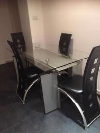 Beautiful glass dining room table and four chairs for sale
