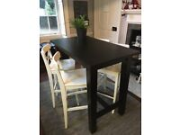 50% off of a set of 4 bar chairs and 1 bar Table