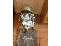 A baby bouncer - in immaculate condition. Purchased brand new and only used by one child