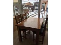 Solid oak extendable dining table with 4 matching chairs