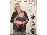 Brand New, never used. Baby sling, carrier.