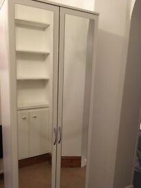 White wardrobe with mirrored panels 18 months old