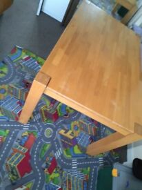 Solid heavy table in light wood