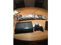 PS3 with 15 games and 2 controllers