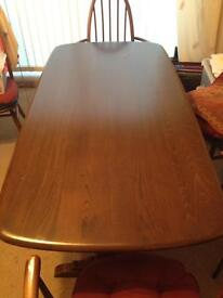 Ercol dining table with 6 chairs