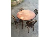 4 solid wood dining chairs and table