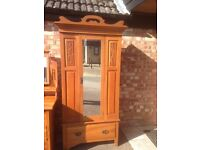 vintage wardrobe, warm honey pine colour with art noveau decoration.