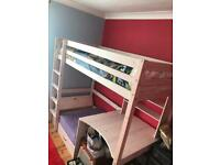 Cabin bed with desk and sofa which pulls out to extra bed