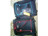 Two new carry-on suitcases