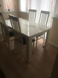 White gloss table and 4 chairs