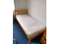 Wooden single bed and matress free