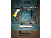 Makita router 110v used 2 times like new