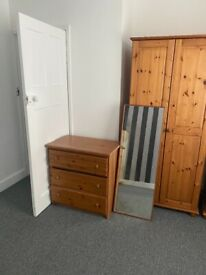 Matching pine Wardropes mirror and chest of drawers.
