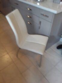 2 Opus cream dining chairs