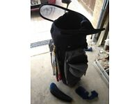 Full set of slazenger scorcher golf clubs, trolley bag, and Ben Sherman utility iron