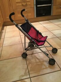 TWO PINK AND NAVY DOLLS PUSHCHAIRS