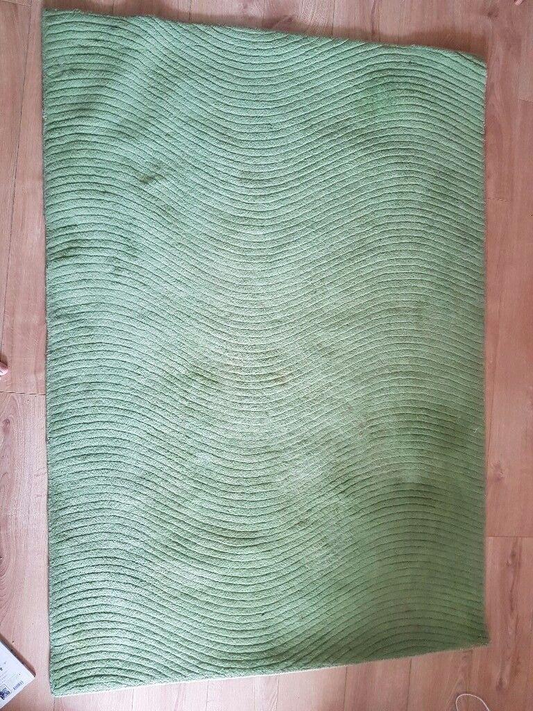 M&S green wool rug