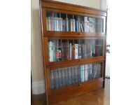 Three shelved vintage bookcase with individually opening leaded glass doors