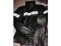 100% leather ladies biker jacket, as new never worn protected arms size small. Can post.