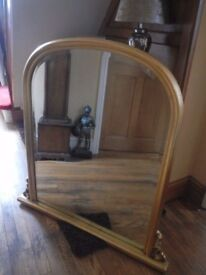 Arched over mantle mirror