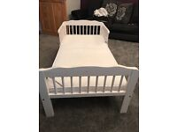 White toddler bed. new mamas and papas mattress slept in a few nights. Few chips as per photos.
