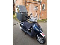 Piaggio Fly 125cc 3V scooter 2015 +Top Box+HotGrip+USB charger+Leg Cover+Muffs. Very good condition.