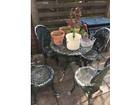 Metal table and 4 Matching chairs