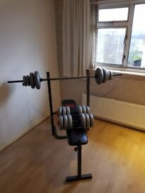 weights bench with barbell and dumbbells