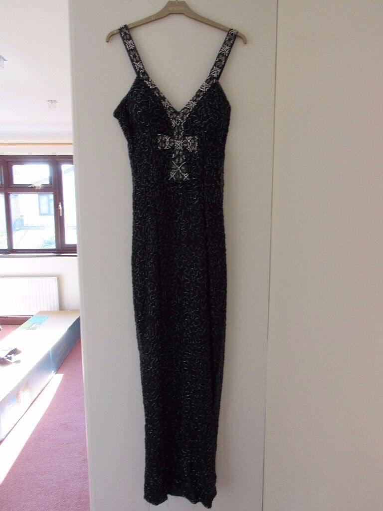 Evening dress Size 12in Canvey Island, EssexGumtree - This beautifully embellished evening dress is in midnight blue and covered with a multitude of bugle beads. The bodice has structured cups. Rear zip. Made by Roots. Size 12