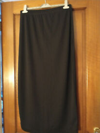 Ladies smart skirt. Size 18. Black. Thin ribbed, stretchy, figure-hugging skirt.
