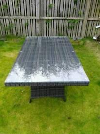 Glass top rattan table