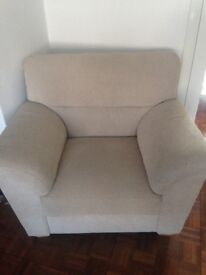 Large hardly used armchair in neutral fabric.
