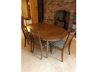 G Plan 1970s extendable dining table and six matching chaira
