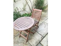 Round garden table and two chairs