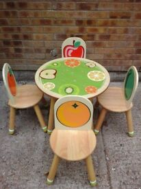 Cute round wooden table and 4 chairs