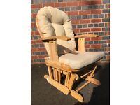 Reclining, gliding nursery rocking chair