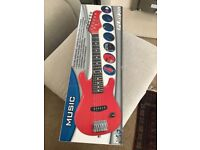 Toys r us, electric guitar brand new in box.