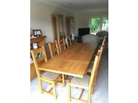 Solid oak extending refectory dining table & 8 upholstered chairs