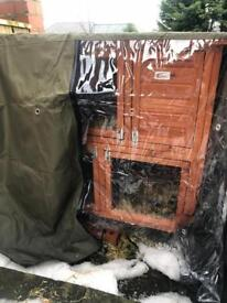 Double hutch with weather proof cover