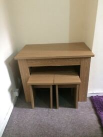 Dining table and 4 stools. Immaculate condition