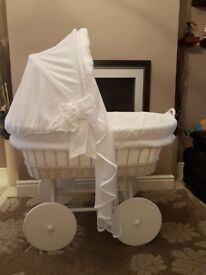 White hooded crib with wheels an net drapes