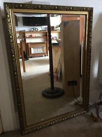 Large ornate gold colour framed mirror