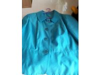 Size 18 Ladies short silk style jacket in turquoise blue.