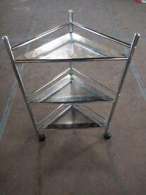 Small metal wheelie corner shelf unit