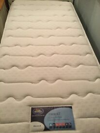 White wooden single bed with silent night mattress. Sprung wooden slats. Really good condition