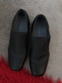 Boys black shoes size 4, only worn once for his prom.